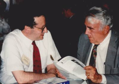 Dr. Moss with Representative Peter Rodino Republican from New Jersey discussing a book by Ralph W. Moss, PhD
