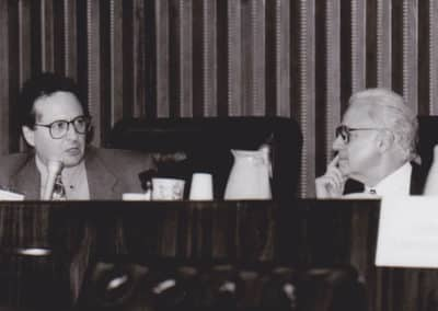 Ralph W. Moss, PhD giving testimony before congress at a committee meeting with Representative Guy Molinari, Republican from New York